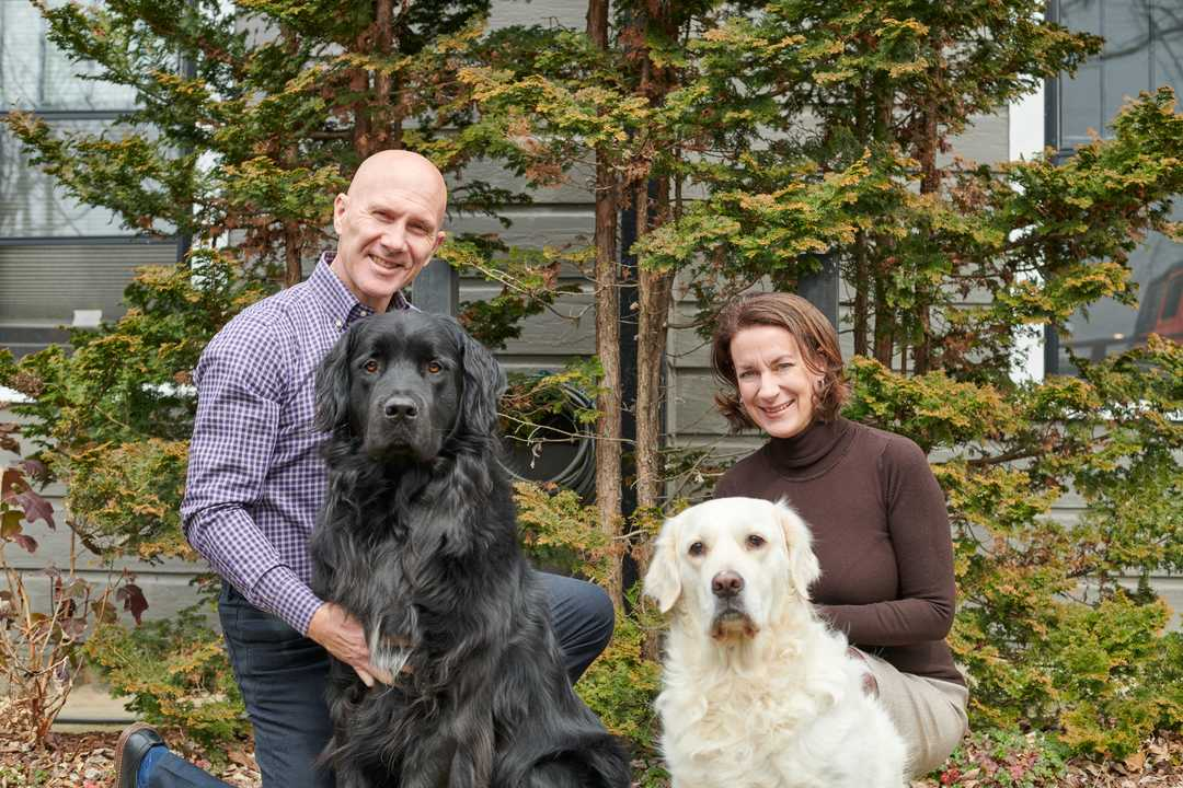 Brian and Beth posing with their two dogs