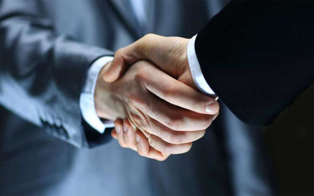 Truck Accident Lawyer handshake with client.